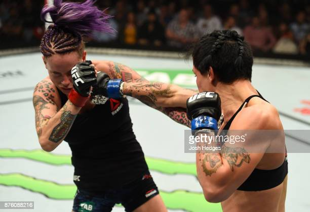 JessicaRose Clark punches Bec Rawlings of Australia in their women's flyweight bout during the UFC Fight Night event inside the Qudos Bank Arena on...