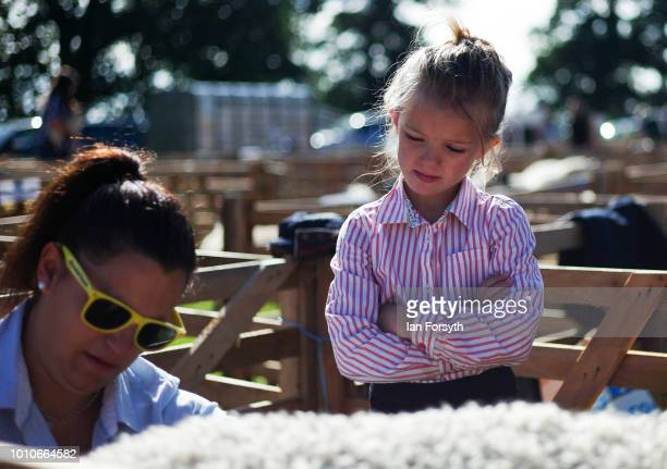 Jessie Barker from Kirbymoorside looks on as her mother prepares one of their sheep for showing during 152nd the Ryedale Country Show on July 31 2018...