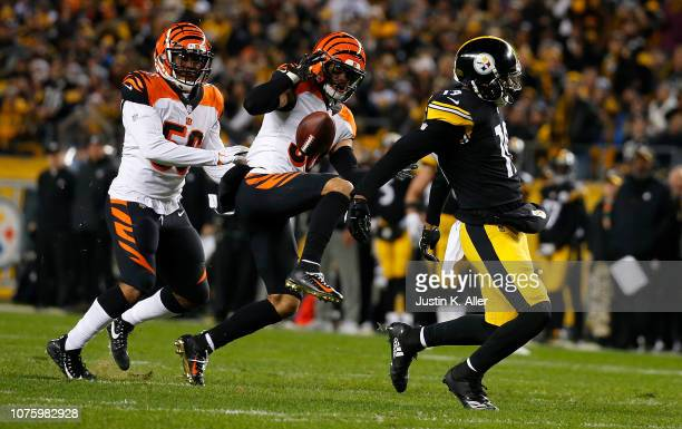 Jessie Bates of the Cincinnati Bengals breaks up a pass intended for JuJu SmithSchuster of the Pittsburgh Steelers in the first half during the game...