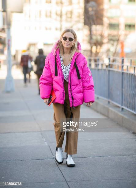Jessie Bush is seen wearing pink puffer jacket outside SelfPortrait during New York Fashion Week Autumn Winter 2019 on February 09 2019 in New York...