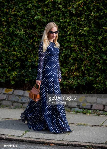 Jessie Bush seen wearing navy dress with dots print outside Stine Goya during Copenhagen Fashion Week Spring/Summer 2020 on August 08 2019 in...