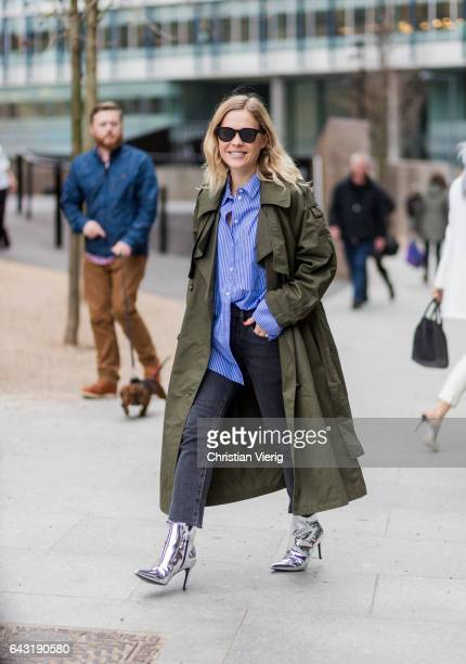 Jessie Bush wearing an olive trench coat outside Topshop Unique on day 3 of the London Fashion Week February 2017 collections on February 19 2017 in...