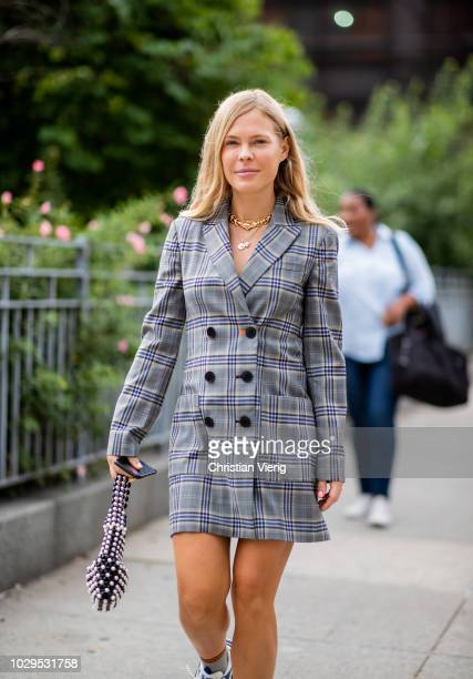 Jessie Bush wearing checked blazer jacket is seen outside SelfPortrait during New York Fashion Week Spring/Summer 2019 on September 8 2018 in New...