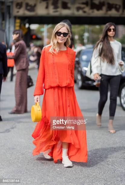 Jessie Bush wearing red dress seen in the streets of Manhattan outside Coach during New York Fashion Week on September 12 2017 in New York City