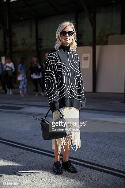 Jessie Bush wearing Stella McCartney top Dion Lee skirt and Loewe handbag arrives ahead of the Ginger and Smart show at MercedesBenz Fashion Week...