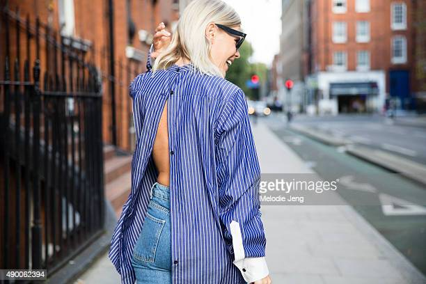 Jessie Bush wears Celine sunglasses a Creatures of Comfort striped shirt Sandroa jeans Rupert Sanderson loafers and a Loewe bag during London Fashion...