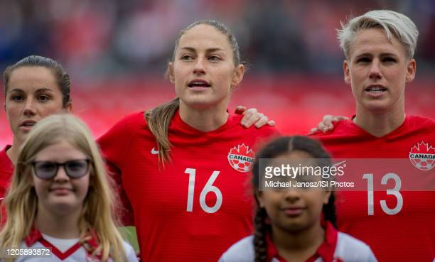 Jessie Fleming Janine Beckie and Sophie Schmidt of Canada look on during a game between Canada and United States at Dignity Health Sports Park on...