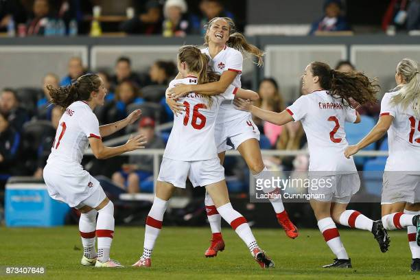 Jessie Fleming, Janine Beckie, Shelina Zadorsky and Allysha Chapman of Canada celebrate after Janine Beckie scored a goal against the United States...
