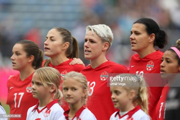 Jessie Fleming Jordyn Huitema Sophie Schmidt and Captain Christine Sinclair of Canada stands during the National Anthem before the Final game between...