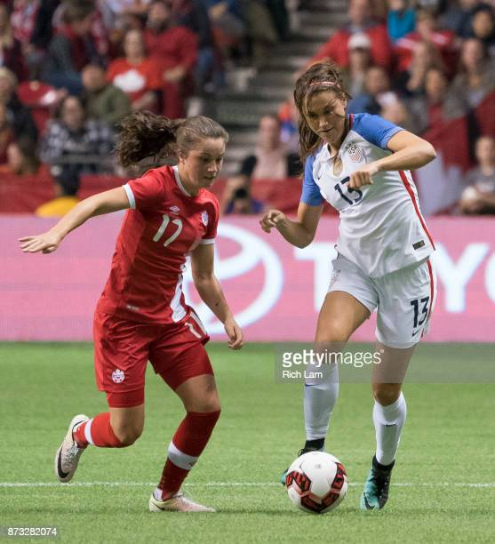 Jessie Fleming of Canada and Alex Morgan of the United States battle for the ball during International Friendly soccer match action at BC Place on...