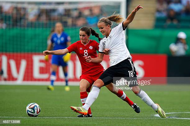 Jessie Fleming of Canada and Lena Petermann of Germany and battle for the ball during the FIFA U20 Women's World Cup Canada 2014 Quarter Final match...