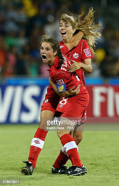 Jessie Fleming of Canada celebrate with Sarah Kinzner after she scores her team's opening goal during the FIFA U17 Women's World Cup 2014 group B...
