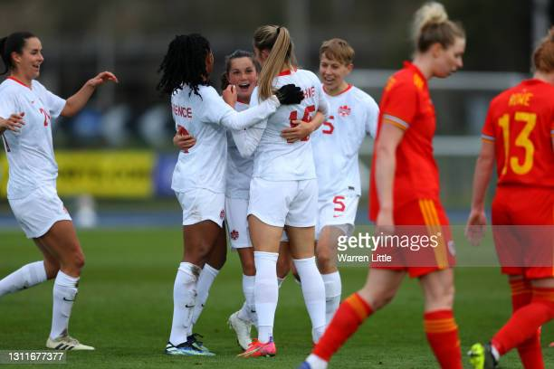 Jessie Fleming of Canada celebrates with teammates Ashley Lawrence and Janine Beckie after scoring their team's third goal during the Women's...