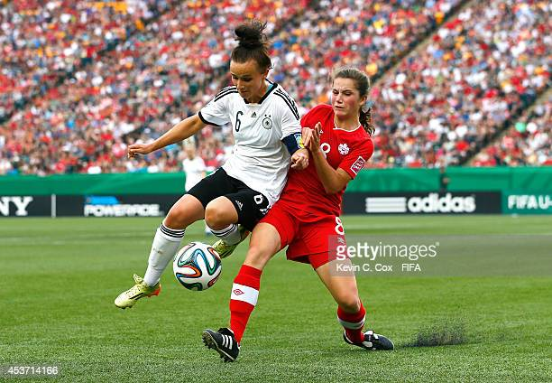 Jessie Fleming of Canada challenges Lina Magull of Germany during the FIFA U20 Women's World Cup Canada 2014 Quarter Final match between Germany and...