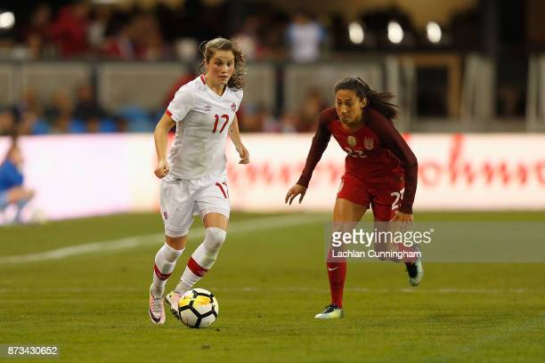 Jessie Fleming of Canada evades Christen Press of the United States during a friendly match at Avaya Stadium on November 12 2017 in San Jose...