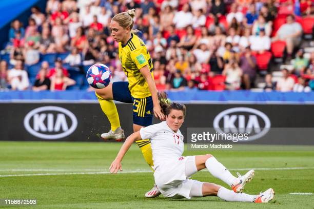 Jessie Fleming of Canada fights for the ball with Amanda Ilestedt of Sweden during the 2019 FIFA Women's World Cup France Round Of 16 match between...