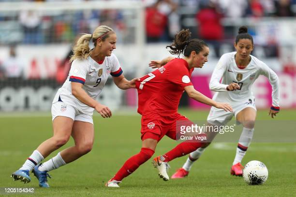 Jessie Fleming of Canada has her shirt pulled by Lindsey Horan of USA during the finals game between Canada and United States as part of the 2020...
