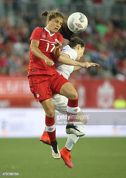 Jessie Fleming of Canada heads the ball against Karen Carney of England during their Women's International Friendly match on May 29 2015 at Tim...