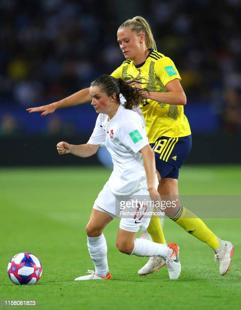 Jessie Fleming of Canada is challenged by Fridolina Rolfo of Sweden during the 2019 FIFA Women's World Cup France Round Of 16 match between Sweden...