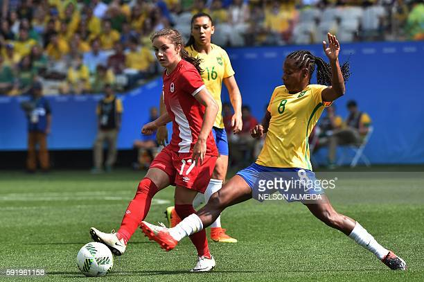 Jessie Fleming of Canada vies for the ball with Formiga of Brazil during their Rio 2016 Olympic Games women's bronze medal football match between...