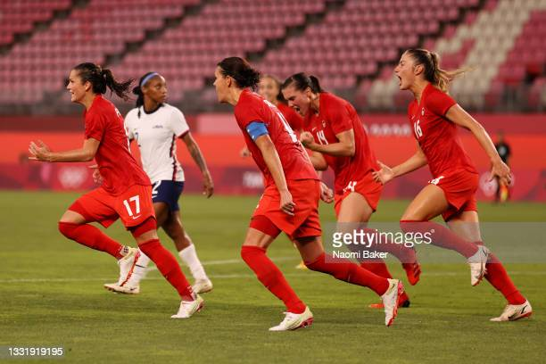 Jessie Fleming of Team Canada celebrates after scoring their side's first goal during the Women's Semi-Final match between USA and Canada on day ten...