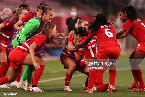 Jessie Fleming of Team Canada celebrates with team mates after scoring their side's first goal during the Women's Semi-Final match between USA and...