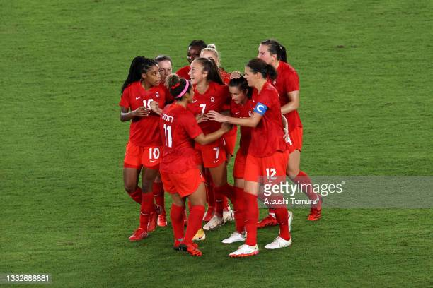 Jessie Fleming of Team Canada celebrates with team mates after scoring their side's first goal during the Women's Gold Medal Match between Canada and...