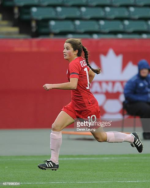 Jessie Fleming of team Canada in action against team Japan during a match at Commonwealth Stadium on October 25 2014 in Edmonton Alberta Canada