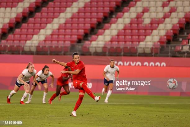 Jessie Fleming of Team Canada scores their side's first goal from the penalty spot during the Women's Semi-Final match between USA and Canada on day...