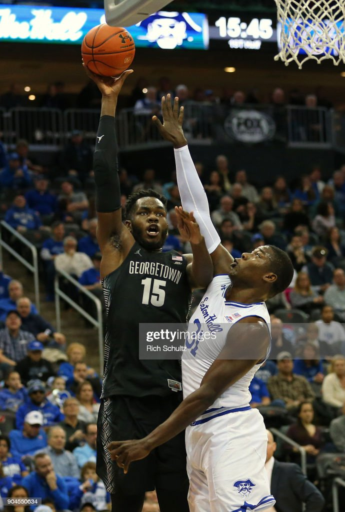 Jessie Govan #15 of the Georgetown Hoyas attempts a shot as Angel Delgado #31 of the Seton Hall Pirates defends during the first half of a game at Prudential Center on January 13, 2018 in Newark, New Jersey. Seton Hall defeated Georgetown 74-61.