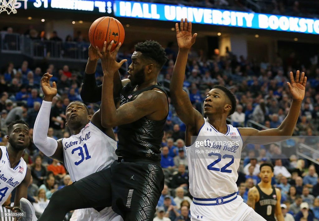 Jessie Govan #15 of the Georgetown Hoyas attempts a shot as Angel Delgado #31 and Myles Cale #22 of the Seton Hall Pirates defend during the first half of a game at Prudential Center on January 13, 2018 in Newark, New Jersey. Seton Hall defeated Georgetown 74-61.