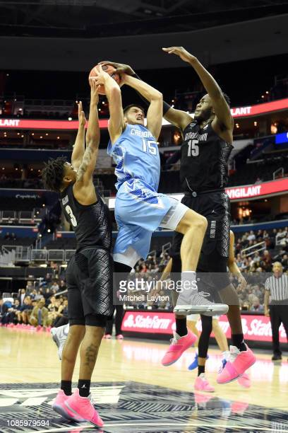 Jessie Govan of the Georgetown Hoyas blocks Martin Krampelj of the Creighton Bluejays shot during a college basketball game at the Capital One Arena...