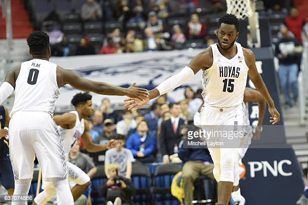 Jessie Govan of the Georgetown Hoyas celebrates a basket LJ peak during a college basketball game against the UNCGreensboro Spartans at the Verizon...