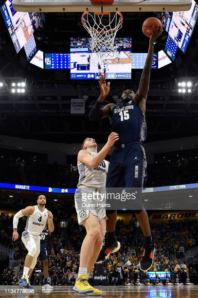 Jessie Govan of the Georgetown Hoyas shoots a lay up in the second half against Sam Hauser of the Marquette Golden Eagles at Fiserv Forum on March 09...