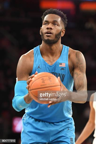 Jessie Govan of the Georgetown Hoyas takes a foul shot during a college basketball game against the St John's Red Storm at Madison Square Garden on...