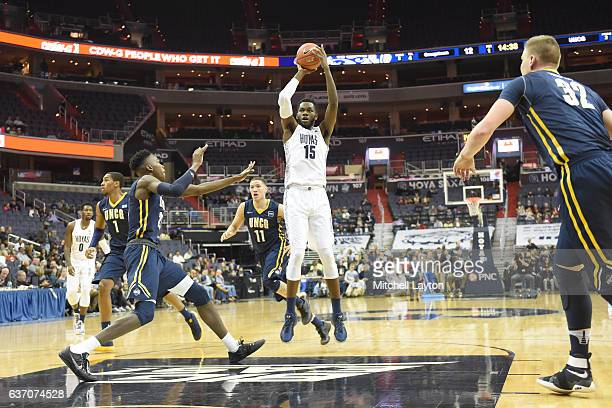 Jessie Govan of the Georgetown Hoyas takes a jump shot during a college basketball game against the UNCGreensboro Spartans at the Verizon Center on...