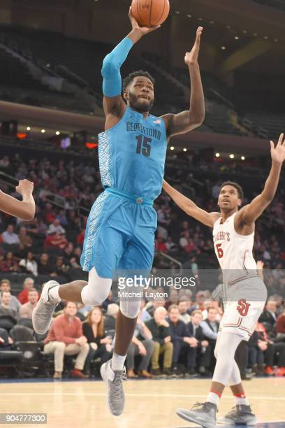 Jessie Govan of the Georgetown Hoyas takes a shot during a college basketball game against the St John's Red Storm at Madison Square Garden on...