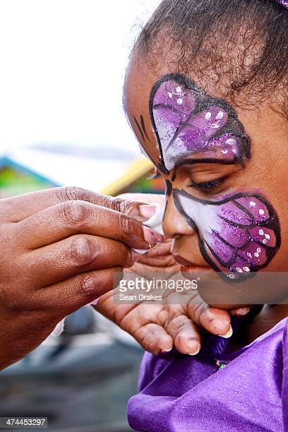 Jessie Harewood receives makeup before performing at the Red Cross Junior Carnival competition on February 22 2014 in Port of Spain Trinidad Tobago