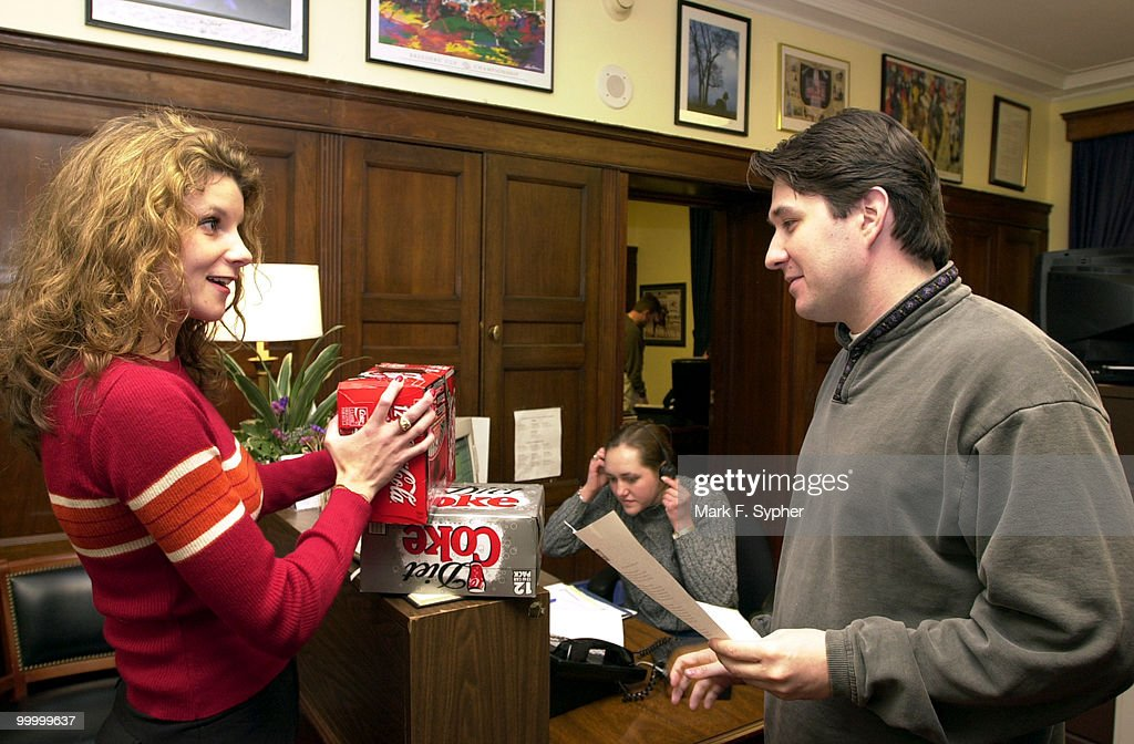 Jessie Howe, left, one of NFIB's House side lobbyists, delivered a case of soft drinks to Mike Malaise, right, press secretary to Rep. Kenneth R. Lucas (D-KY), in the Longworth Building on Tuesday to represent AHP's (see press release in photo dept.), an issue involving offering more affordable healthcare to small-business owners. Katie Ray is in the background.
