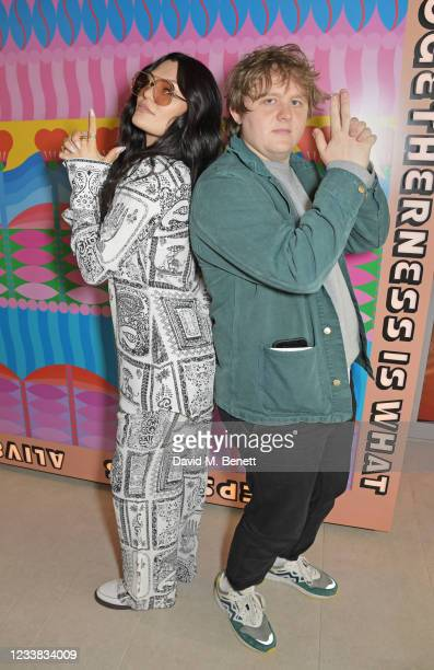Jessie J and Lewis Capaldi pose in evian's VIP suite, certified as carbon neutral by The Carbon Trust, during day eight of The Championships at...