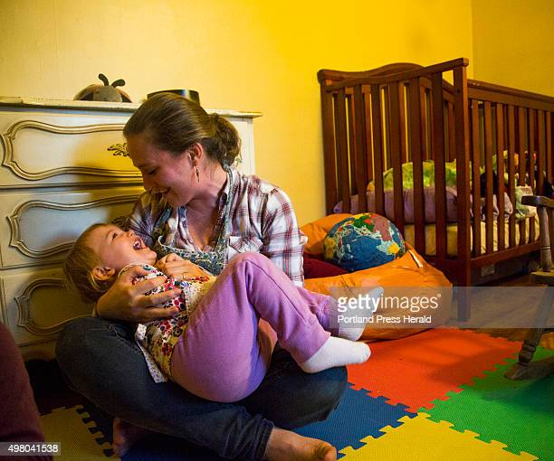 Jessie Kessler holds her daughter Lyla in her room which she shares with her sister Cadence in South Portland, ME on Monday, October 26, 2015.