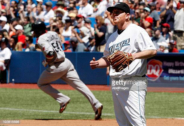 Jessie Litsch of the Toronto Blue Jays reacts after giving up a tworun home run to Darnell McDonald of the Boston Red Sox during the game at the...