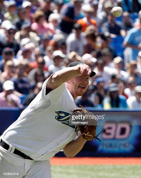 Jessie Litsch of the Toronto Blue Jays throws to first for an out against the Boston Red Sox during a MLB game at the Rogers Centre July 11 2010 in...