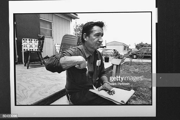 Jessie Lloyd Misskelley, father of accused murderer Jessie Lloyd Misskelley Jr., sitting on stairs outside his mobile home; Misskelley Jr., Michael...