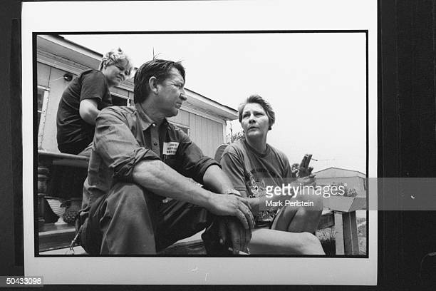 Jessie Lloyd Misskelley, father of accused murderer Jessie Lloyd Misskelley Jr., w. Wife Lee Rush & Stephanie Dollar sitting on stairs outside his...