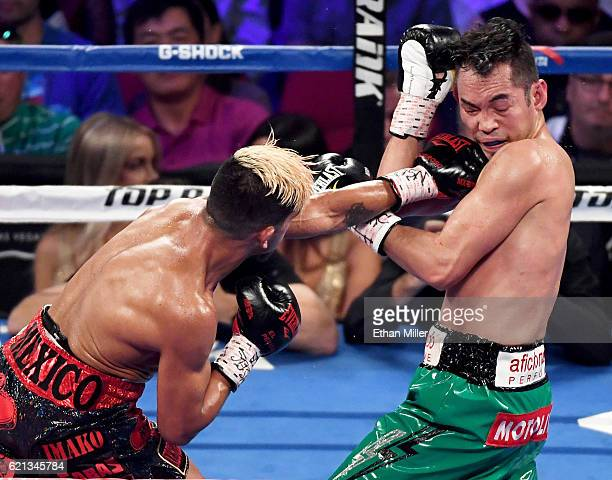 Jessie Magdaleno throws a left at Nonito Donaire in the fifth round of their WBO junior featherweight championship fight at the Thomas Mack Center on...