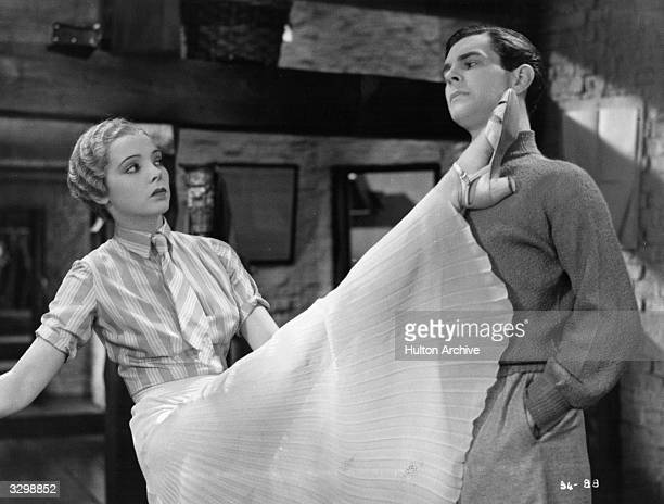 Jessie Matthews and Barry MacKay star in the musical 'Evergreen' directed by Victor Saville for Gaumont