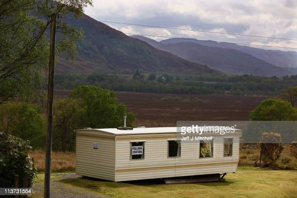 Jessie McKay peers out of a caravan window as she and her husband George await voters on May 5 2011 in Coulags Scotland Voters will go polls today to...