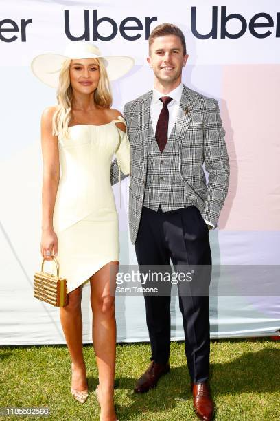 Jessie Murphy and Marc Murphy arrive at Lexus Melbourne Cup Day at Flemington Racecourse on November 05 2019 in Melbourne Australia