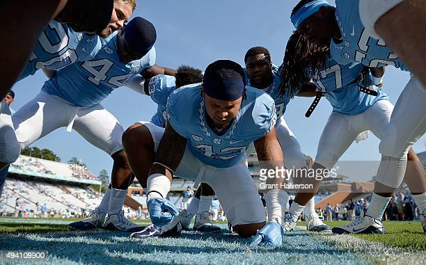 Jessie Rogers of the North Carolina Tar Heels leads the chants in a pregame huddle before their game against the Virginia Cavaliers at Kenan Stadium...